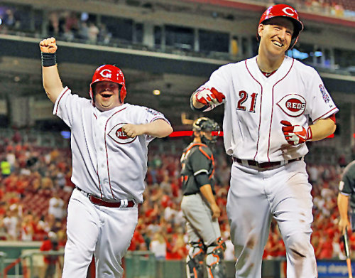 "Teddy was a batboy for the Reds game Thursday when he announced in bits and pieces that he wanted three things: 11 runs for the Reds, 11 strikeouts for the pitching staff — a local pizza company, LaRosa's, gives fans a free pizza when the Reds whiff 11 batters, and Teddy loves that pizza — and a home run for Todd Frazier. The Reds scored those 11 runs and recorded those 11 strikeouts. As for Frazier, this is what Teddy told him before his at-bat in the sixth inning: ""Come on, hit me a home run, I love you."" And this is what Frazier told Teddy: ""I love you too. I'll hit you one."" I love you too. That's reason No. 1 why Todd Frazier is my favorite player. Not that he promised Teddy a home run, but because he told Teddy, ""I love you too."" Ballplayer or not, who does that? What grown man tells another grown man that? My favorite player does. (via Frazier comes through for batboy, making him my favorite - MLB - CBSSports.com)"
