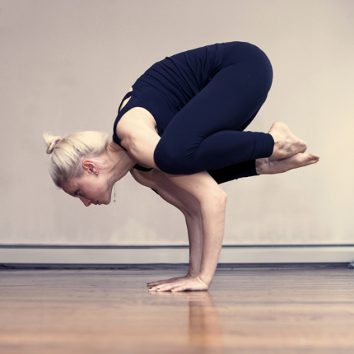 Crow Pose, otherwise known as Bakasana, is a popular yoga arm balance.  It strengthens the wrists and arms as well as the abs.  Crow pose also helps to open the groin muscles.  I always like to remind people when I teach this pose to look about a foot in front of them versus straight down otherwise a crow can become a somersault.  Another tip is to keep your elbows within shoulder distance apart.