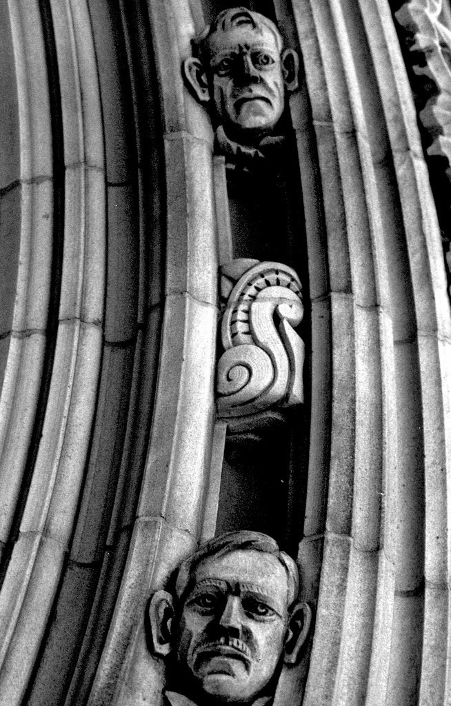 Faces within the stonework at Yale.