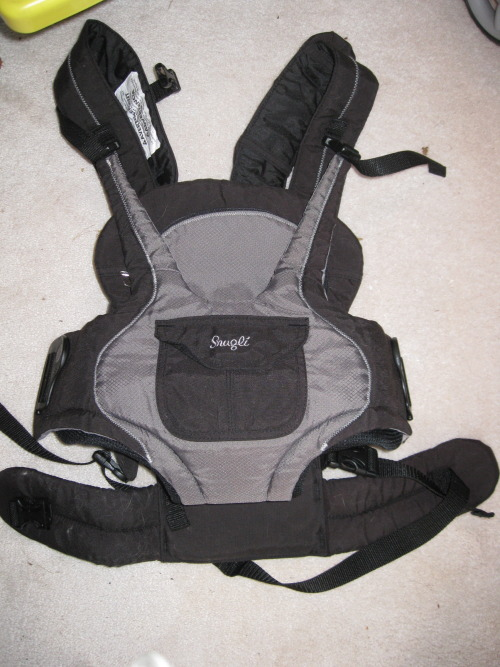 For sale for $10.  I have a used Snugli black and gray soft carrier that can be used front and back. It can hold from 7-26lbs. From a smoke and pet free home. Thanks for looking.- Dual side entry buckles: Buckles open with just 1 hand so you can easily take a sleeping baby out.- Removable shoulder pads: Pad keeps shoulders comfortables.- Two-position adjustable seat: Easily adjust to fit growing baby.- Zip-away panel with mesh ventialation: Keep baby cool and comify.- Easy clean fabic: Wipes easily or machine wash.- Confort waist belt: Supports lower back.- Padded leg opening: Keeps baby comfortable.For directions and answers to any questions you may have, please call 503-724-2538.