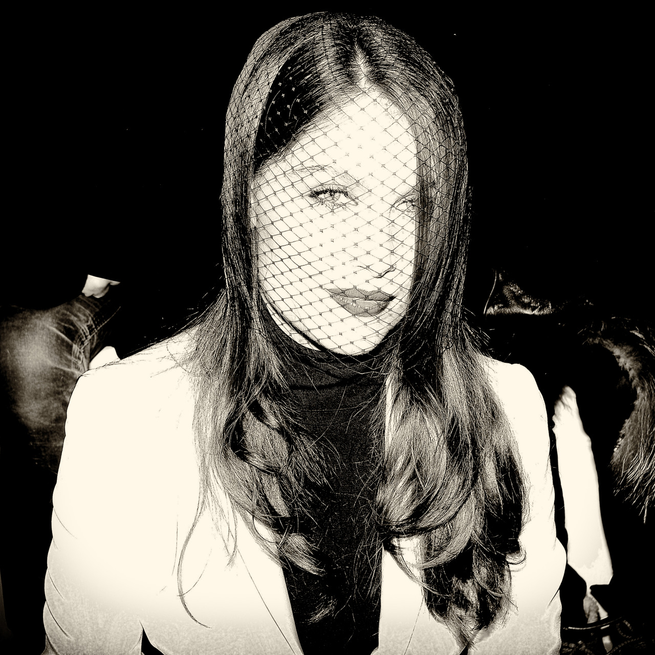 Laetitia Casta at Dior show in Paris looking mysterious in her voile headpiece.
