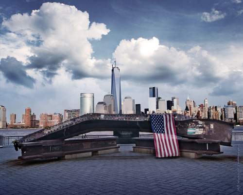 jeffwickliffe:  Never Forget on Flickr.A shot of the Freedom Tower before it was finished from the Jersey side of the river. The twisted beam in the foreground is from the wreckage of 9/11. Thought it was poignant to line them up in this shot to show the terrible that happened and the progress toward the future beyond.