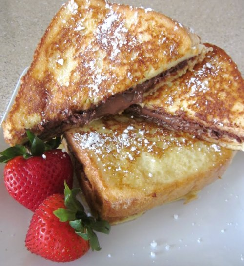 confectionerybliss:  Nutella Stuffed Custard French Toast ♥ click here for recipe ♥