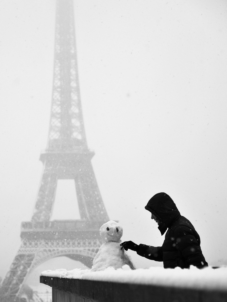 a snowman in the eiffel tower. cute. ❤ allthingseurope:   (by . ADRIEN .)