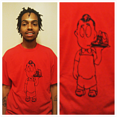 My cousin A rocking the red and black logo tee……