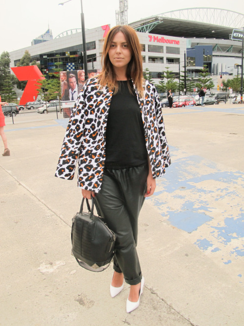 Spicing up the monochrome look at #LMFF with an abstract leopard coat worn over the shoulders, perfectly punctuated with her white pointed heels and structured Alexander Wang tote.  WGSN street shot, L'Oréal Melbourne Fashion Festival