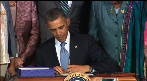 President Obama signs the Violence Against Women Act