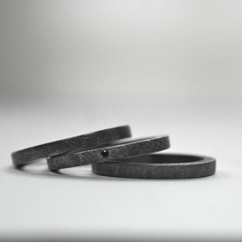Black diamond stacking ring set with oxidized finish.