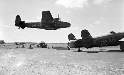 cloggo:  Halifax B Mark II Series 1 (Special), JB911 KN-X, of No. 77 Squadron RAF, making a low level pass over other aircraft of the squadron at Elvington, Yorkshire.  This is an image from the Imperial War Museum Collection. AIRCRAFT OF THE ROYAL AIR FORCE 1939-1945: HANDLEY PAGE HP.57 HALIFAX.© IWM (CH 10594)  From HERE