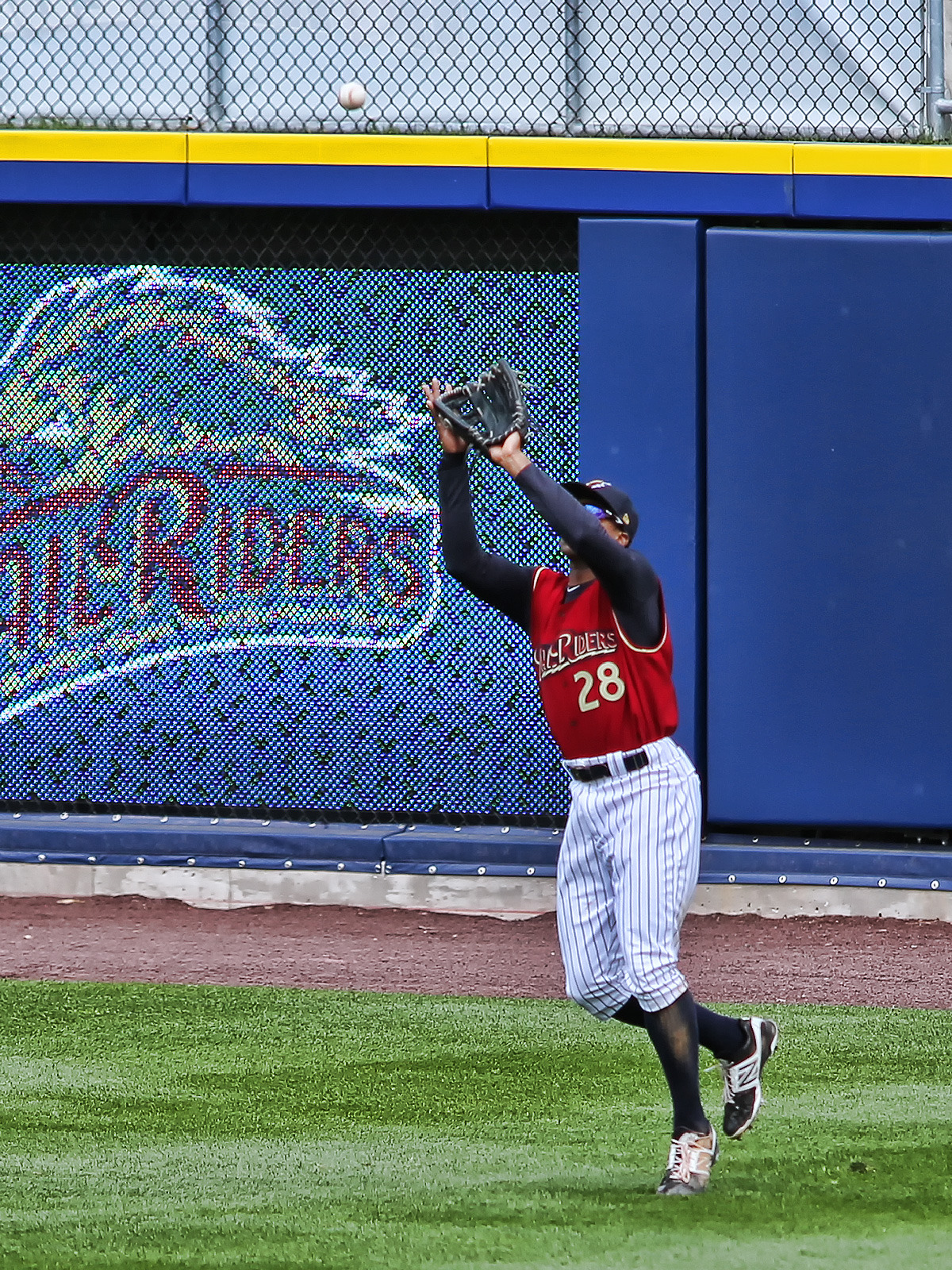Curtis Granderson May 12, 2013 - Curtis Granderson catches a fly ball. He was on rehab assignment with the AAA Scranton/Wilkes-Barre RailRiders.