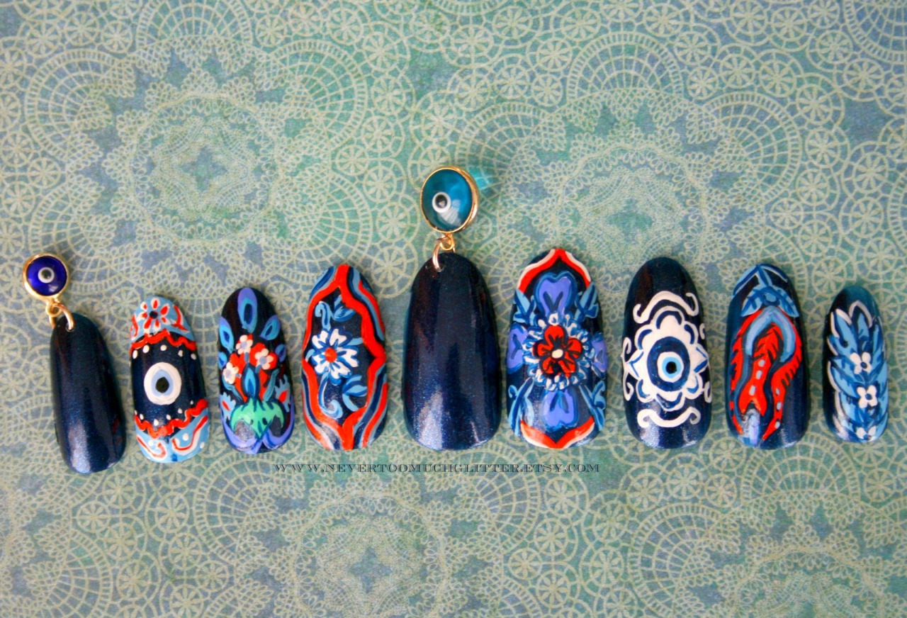 nevertoomuchglitternailart:  Handpainted nails, inspired by Turkish ceramics, with two tiny evil eye dangle charms.  Turkish Delight Nail Art