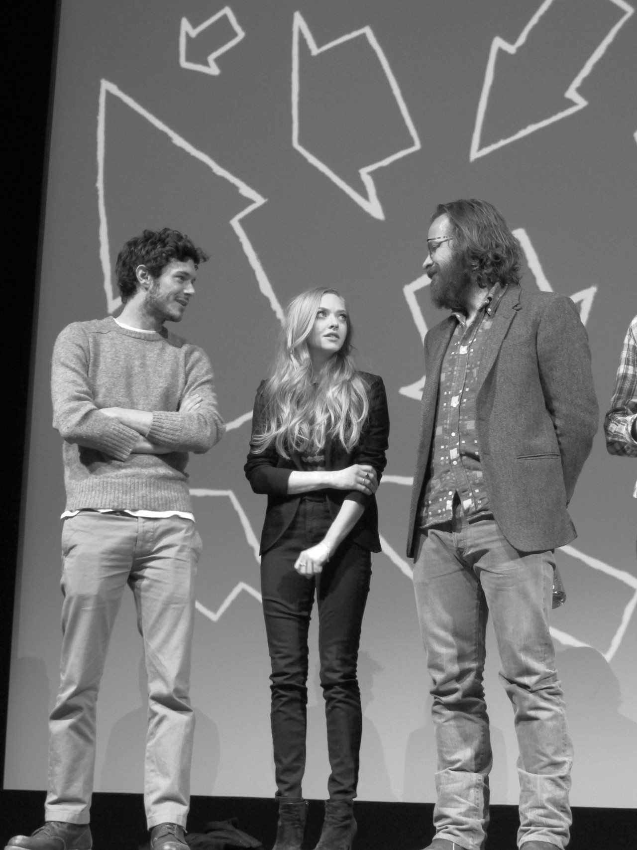 "Sundance Premiere: Lovelace The Inside Source attended the premiere for Lovelace at the Sundance Film Festival. What seemed like a potentially silly movie on porn was instead a profound statement on domestic violence. ""It was a fascinating story to tell,"" Amanda Seyfried admitted to a room of over a thousand applauding guests. ""I was looking for a challenge; it was the perfect fit for me. I wanted to be the voice of Linda. She wanted to be heard, and wrote a bunch of books [to express that]. She was an anti-porn activist, which we didn't get much into in the movie, but she had so much to say. I wanted to make her feel validated."" In an era where porn is more hip than ever, this film questions the dark narratives lurking within. (Adam Brody, Amanda Seyfried, and Peter Sarsgaard. Photo and Text by Jauretsi)"
