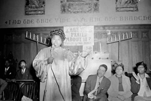Mahalia Jackson at microphone in unidentified church (possibly Gillis Memorial Church)ca. 1949Paul S. Henderson (1899-1988)4x5 inch acetate negativeHenderson Photograph CollectionBaltimore City Life Museum CollectionMaryland Historical SocietyHEN.00.A2-270 Happy Martin Luther King Jr. Day! On August 28, 1963 at the March on Washington for Jobs and Freedom, Mahalia Jackson (gospel singer and civil rights activist) was standing behind Dr. King while he was speaking to over 200,000 people from the steps of the Lincoln Memorial. It is rumored that Jackson encouraged Dr. King to share his speech with the crowd. His I Have a Dream Speech was a defining moment in the struggle for civil rights.  And congratulations to President Barack Obama! In case you missed his speech, you can read the full transcript here (Huffington Post).
