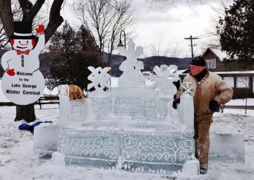 Sculptor Glenn Durlacher, his dog Donny, and his creation for this year's Winter Carnival.  Shepard Park Lake George, N.Y. February 1, 2012