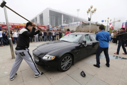 Angry Maserati owner destroys $430,000 car with sledgehammer | wheels.ca  The owner was apparently unhappy with Furi Group, the company responsible for Maserati distribution in the Qingdao area, because they allegedly repaired his  $430,000 Quattroporte with second-hand parts rather than the new parts he paid for and did not make all the repairs he requested.   This supercar-smashing is becoming something of a bizarre tradition at the Qingdao Auto Show. The China Car Times says a Lamborghini owner smashed his exotic ride at the show in 2011 to protest apparent dissatisfaction with Lamborghini China, even though he had bought the car second-hand from Germany.  And here's a video of that Gallardo-smashing: