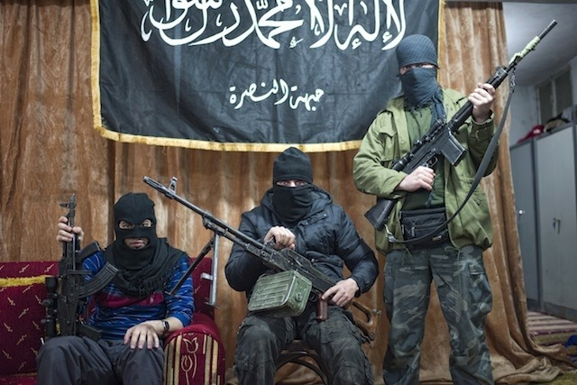"Chatting About Game of Thrones with Syria's Most Feared Islamic Militants ""Ameriki?"" the jihadi asked, pointing at me with a bemused look on his face. I'd just approached him at a house that serves as the local base for Jabhat al-Nusra (JAN), the most feared Islamic militant group operating in Syria. A month ago, his colleagues took over a street right next to my fixer's house, blocking it off and hoisting up the black flag that serves as their symbol. They spend their time milling about outside, sometimes riding off in pickup trucks, the beds overflowing with black-clad young men holding RPGs and AK-47s. Accompanied by a few Free Syrian Army rebels, I was still quite apprehensive about approaching al-Nusra. More experienced journalists had warned me to be wary of them, and the Obama administration had recentlydesignated them as a terrorist group. While the al Qaeda link hadn't yet been made official, it wasconfirmed a couple of days later. Additionally, I had awoken that morning to the news that the FBI had justarrested Eric Harroun, an American who allegedly fought with al-Nusra in Syria. Al-Nusra and other Islamic groups showed up in the Syrian border town of Ras Al Ayn in November, and—along with the Free Syrian Army—forced out the remnants of the Assad regime in fierce, block-to-block fighting. Afterward, this coalition fought against Syria's most powerful Kurdish militia, the Popular Protection Units (YPG). The fighting lasted months before a ceasefire was arranged, and the city was essentially divided in two, with the YPG operating on one side and the FSA and al-Nusra on the other. More recently, al-Nusra had even clashed with an FSA brigade in the nearby town of Tal Abyad, but peace was restored shortly after. At the al-Nusra base in Ras Al Ayn, the jihadi who had asked me if I was American pulled back his fist in an exaggerated motion, then play-acted punching me when I confirmed my citizenship. The man—a cross-eyed Egyptian who I would later learn served as the group's public-relations officer and preacher, of sorts—laughed heartily. ""Watch out, we're terrorists!"" his colleague, a lanky Emirati with facial hair reminiscent of Orlando Bloom chimed in, before he started laughing, too. The Emirati then excitedly asked me what part of New York City I was from. ""Oh, Brooklyn? Yeah, I know it. I went to school in Seattle for a year,"" he said. Continue"