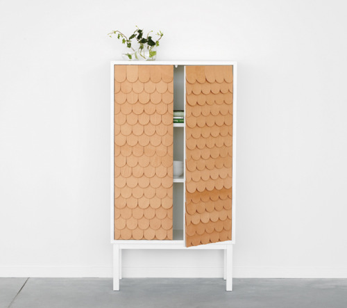 fromscandinaviawithlove:  Collect cabinet by Swedish Sara Larsson/A2.  The cabinet has a fish scale patterned front made in Tärnsjö leather and comes with a signed and numbered metal plate.