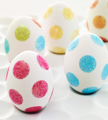 MAKE > Easter Fun No-Dye Easter Eggs. Place glue dots on egg and roll in glitter.