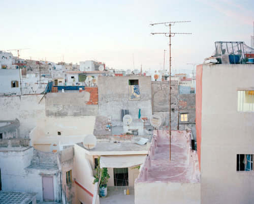 Cait Oppermann - Tangier in pastels, Morocco, 2012. I recently unearthed this photo from a stack of negatives that I haven't touched since I scanned the film that would become Sea Blues. I really love this one, though. Tangier is not a peaceful city on the ground, but from above it can be actually quite serene.