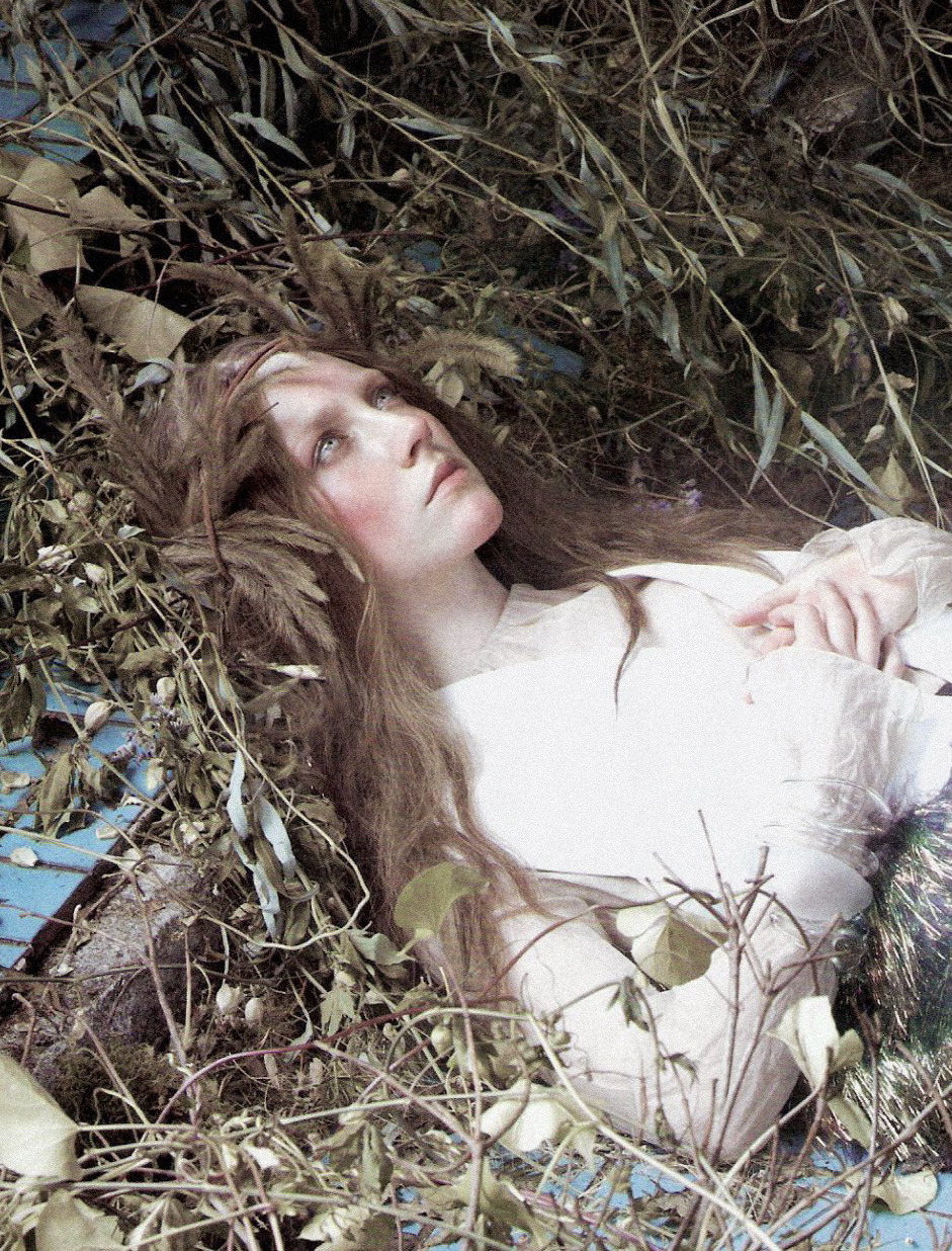 romanticnaturalism:  Saoirse Ronan in 'The Cult of Beauty' photographed by Steven Meisel and styled by Grace Coddington for Vogue US December 2011  Death and the Maiden: Recalling the iconic image of Sir John Everett Millais's Ophelia, Ronan captures the troubled heroine's fateful scene. Saoirse wears a Balenciaga silk crepe dress, silk-and-cotton top and bracelets.