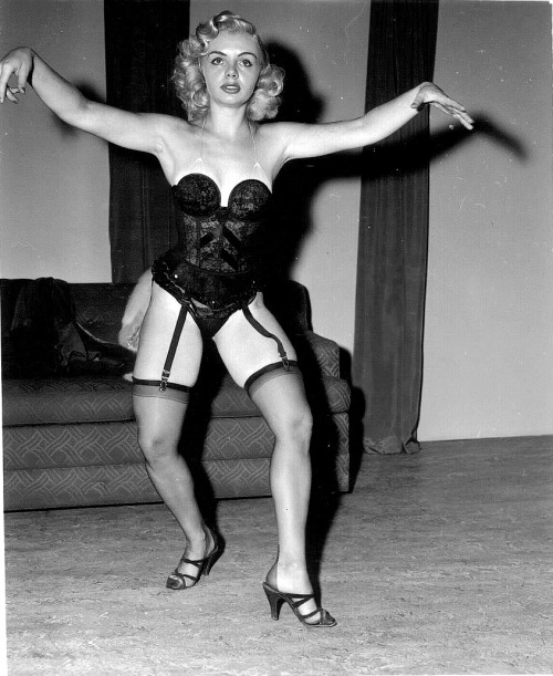 Rita Grable From a 50's-era photo series shot by Irving Klaw..