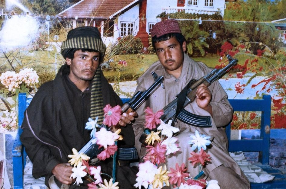 THOMAS DWORZAK HAS PHOTOS OF SAD MARINES AND TALIBAN POSEURS