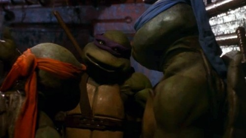 ComicsAlliance Reviews 'Teenage Mutant Ninja Turtles' (1990), Part One By Chris Sims Chris Sims: Welcome to ComicsAlliance's ongoing series of in-depth movie reviews and the start of another round! When we finished up our first set on the '90s independents, we let you, the readers, vote on what we'd sit through next, and the result was our closest contest yet. In the end, though, the Punisher, classic comic strips and fighting games all fell before the unstoppable might of Turtle Power. Matt Wilson: So thanks to you guys we're spending Super Bowl Sunday like any red-blooded American would: watching anthropomorphic turtles named after renaissance artists eat pizza, fight ninjas and talk to a giant rat.
