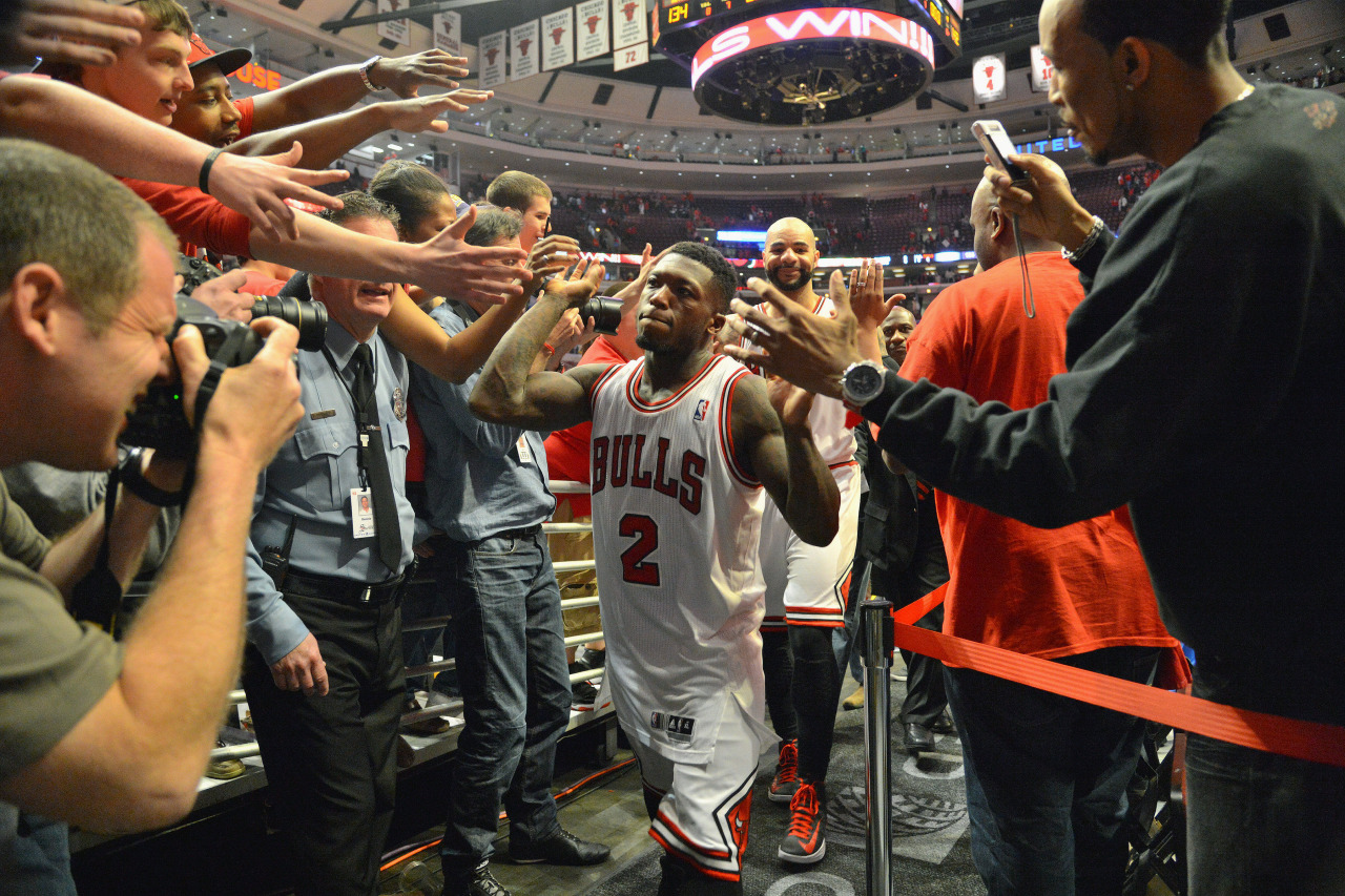 nba:  Nate Robinson of the Chicago Bulls high-fives fans after the win in triple over time against the Brooklyn Nets in Game Four of the Eastern Conference Quarterfinals during the 2013 NBA Playoffs on April 27, 2013 at United Center in Chicago, Illinois. (Photo by Jesse D. Garrabrant/NBAE via Getty Images)