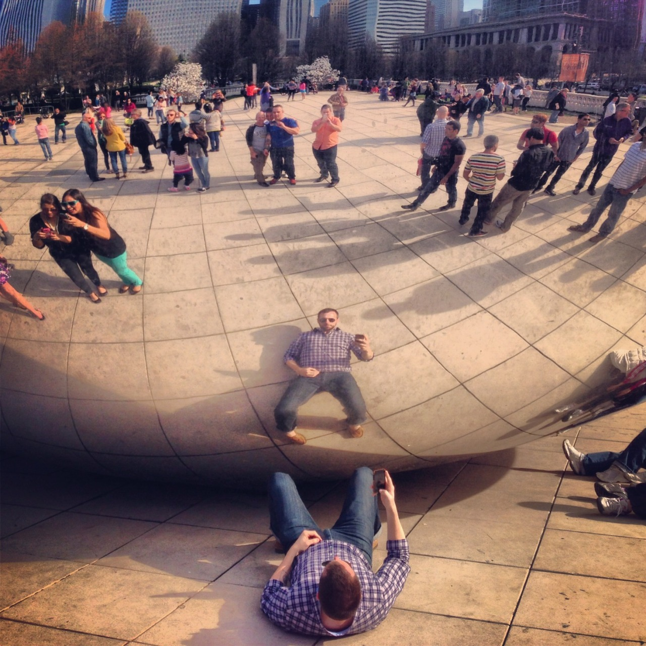 A friend captured my attempt at taking a 'unique' picture at the bean last weekend.  Instead they all just made it look like I was doing something obscene in public.