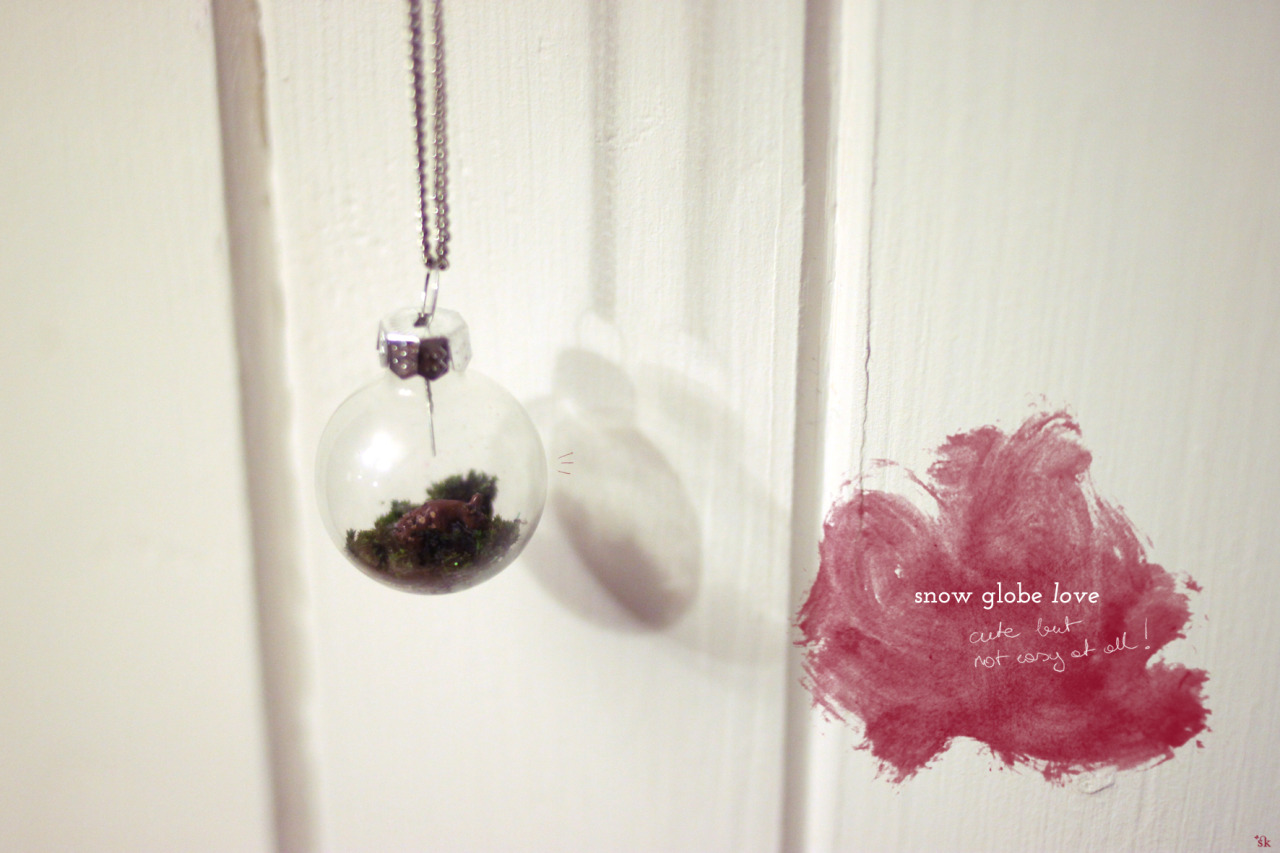 i've been trying to make this little snow globe necklace for days now. at first i tried to use superglue to stick the tiny deer to the ground of the glas ball, this didn't end well. not only did i nearly glue my fingers together but the snow globe went all foggy and the deer fell down andways… so much for super glue huh?   now i tried to glue it there with plain craft glue. i put in the moss first with a drop of glue… pushed the moss down with a pair of tweezers and then positioned the deer there. also with the tweezers. this is not easy and super annoying. but it looks cute now. the only other problem is… you can't really photograph this tiny little something through the glas… i how you can imagine how cute it looks?