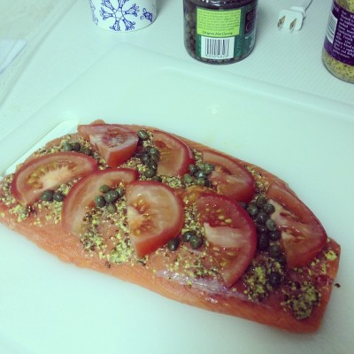 Salmon about to hit the oven. It's spiced up with whole grain Dijon mustard, sliced tomato and capers.