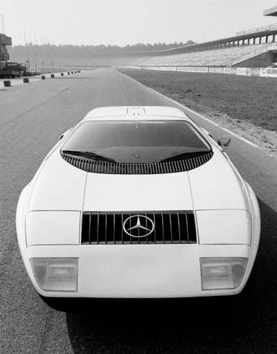 The 1969 Mercedes C111 was a research project, undertaken by Mercedes to develop new technologies. The company wanted to produce a rotary engined car, so research was under taken into the Wankel engine. The C 111 of 1969 featured a 3 rotor Wankel engine and developed 280 bhp, with a top speed of 160mph. The C111 was first displayed by Mercedes-Benz in September 1969 at the Frankfurt International Motor Show (IAA). The C 111-II was introduced to the public at the Geneva Motor Show in March 1970, to much aclaim. It was fitted with a four-rotor Wankel engine with an output of 350 hp and improved engine torque. It gave the car a top speed of 180mph and 0-60mph in 4.8 seconds. The second car featured revised suspension configurations, allowing for wide tyres and the body work was made from plastic to reduce weight and improve aerodynamic efficiency. However, the Wankel engine had a high fuel consumption and emissions. Any hope the car would be put into production was stopped by strigent emission legislation in many countries and the 1973 oil crisis.  http://www.lotusespritturbo.com/Mercedes_C111.htm