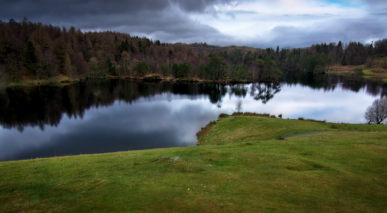 Today's Photo Tarn of Man. Tarn Hows is definitely a lake I have to visit again. It's actually been helped by the hand of man; there was of course originally three tarns here before they were merged into one (and you can see more beautiful photos of them here). This was shot on Boxing Day, so pretty darn cold! And not a lot of lush vegetation around. Also, this photo saw some severe cropping going on, I had originally shot it with my sweet, sweet Tokina 11-16mm but preferred a tighter crop to maximise those reflections! You should order yourself a beautiful print of this photo right here.