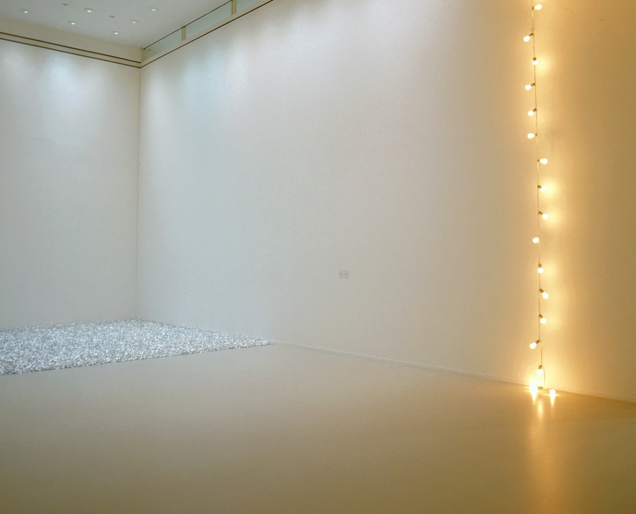 Félix González-TorresOne of my favourite artists. Once dazzled by the warm glow of the light installation, the viewer is invited to take a sweetie from the floor.