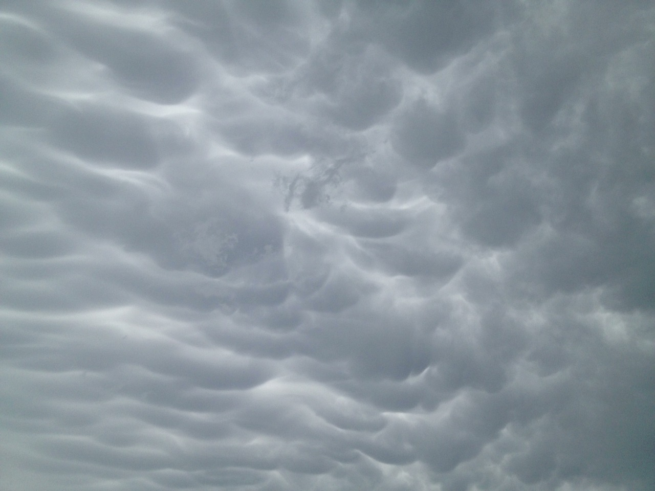 Current sky above Norman, OK — about 20 mins south of Oklahoma City.  My husband is there to be with his dad, who is having open heart surgery tomorrow.  Good thoughts for both them and the whole frigging state appreciated.