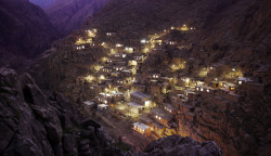 "From A Trip to Iran, one of 20 photos. Palangan Village, in the mountains near the Iraq border. Palangan, illustrative of many of the country's rural settlements, has benefited handsomely from government support. Many villagers are employed in a nearby fish farm, or are paid members of the Basij, whose remit includes prevention of ""westoxification"", and the preservation of everything the 1979 Islamic revolution and its leader the Ayatollah Khomeini stood for, including strict rules on female clothing and male/female interaction. (© Amos Chapple)"