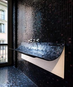 aros:  Mosaic curved sink.