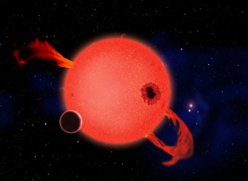 smithsonian:  When it's young, a red dwarf star frequently erupts with strong ultraviolet flares as shown in this artist's conception. Some have argued that life would be impossible on any planet orbiting in the star's habitable zone as a result. However, the planet's atmosphere could protect the surface, and in fact such stresses could help life to evolve. And when the star ages and settles down, its planet would enjoy billions of years of quiet, steady radiance. (via Earth-like planets discovered right next door to Earth | Smithsonian Science)