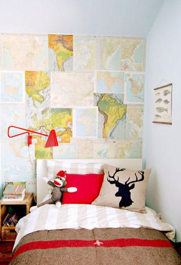 DIY IDEA: Create an accent wall by pinning up layers of maps in all shapes and sizes. MORE DIY DECOR IDEAS Photo via www.alovelylark.com