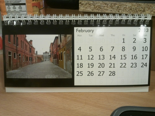 February on the desk calendar with pictures from last year's Venice trip.