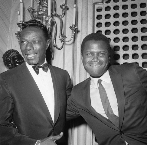 "vintageblackglamour:  Sidney Poitier and Nat ""King"" Cole cutting up at the 1963 #Oscars at the Santa Monica Civic Auditorium, April 8, 1963. Photo: Michael Ochs Archives, Corbis.  Can't help but to think of that Chapelle skit…lol"