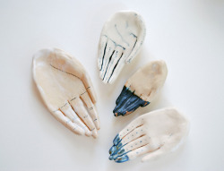 noceuse:  ceramic hands by kaye blegvad on Flickr.