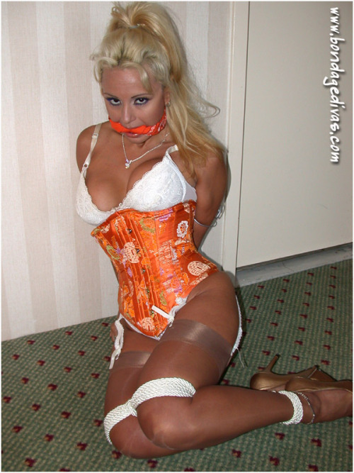 graybandanna:Stacy Burke all tied up and gagged with a matching orange bandanna