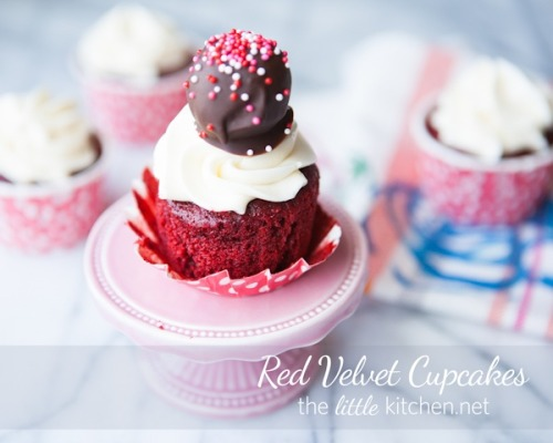 red velvet cupcakes with cream cheese frosting and truffles.