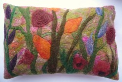 Soft and beautiful felted Merino Wool cushion.   A blend of colours depicting flowers in a meadow.   Available from VixCrafts facebook page or www.etsy.com/shop/vixcrafts