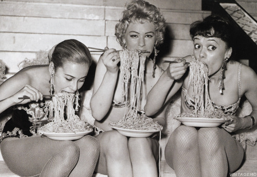 theniftyfifties:  Showgirls at the Soho Fair spaghetti eating contest, July, 1958