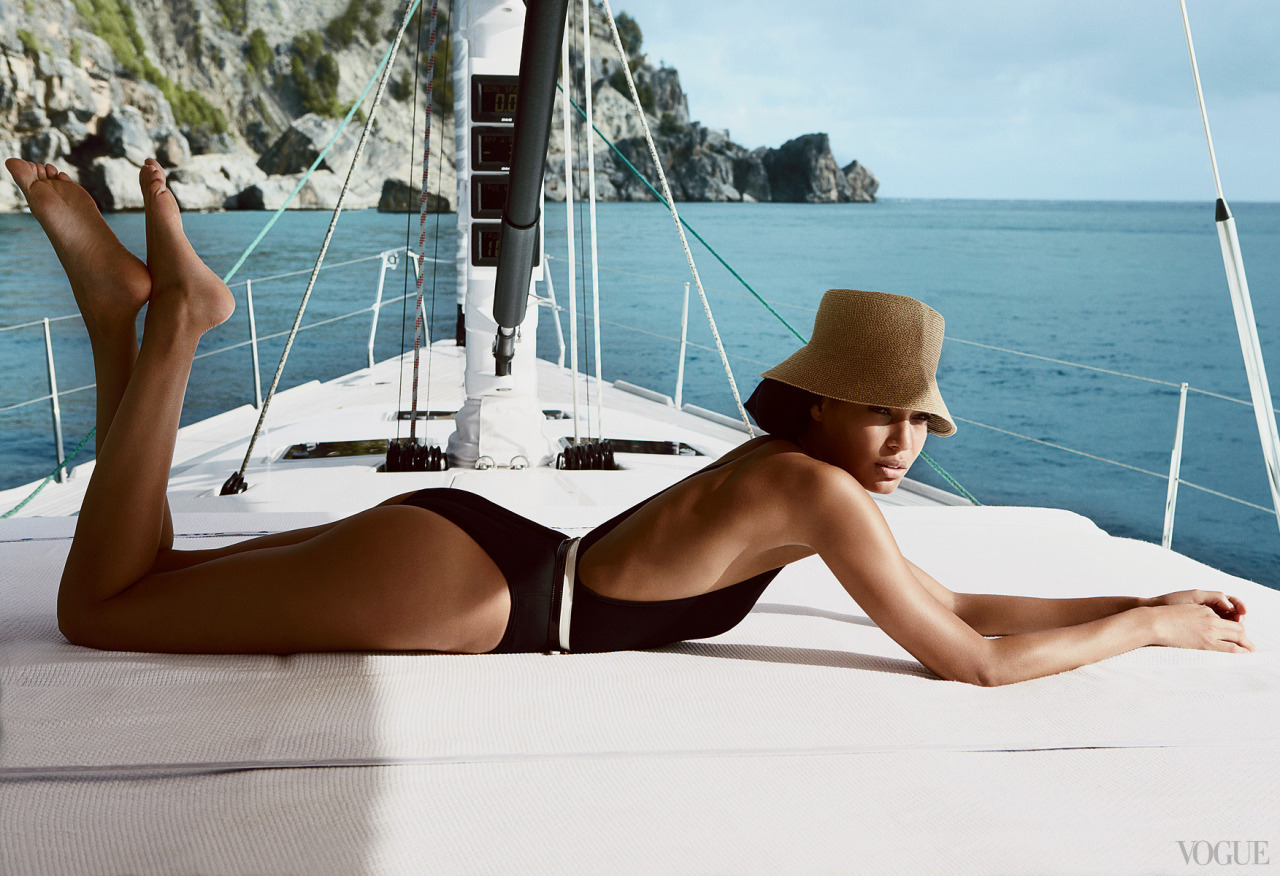 vogue:  Joan Smalls in a Lanvin deep V–neck bodysuit, $690.photographed by Patrick DemarchelierFor more photos of the model in St. Barth's, go to Vogue.com.