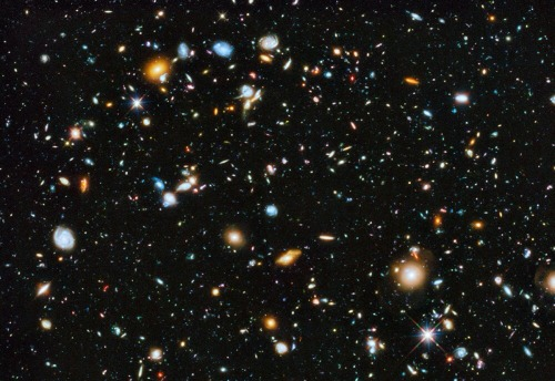 Hubble Ultra Deep Field 2014  Image Credit: NASA, ESA, H.Teplitz and M.Rafelski (IPAC/Caltech), A. Koekemoer (STScI), R. Windhorst(ASU), Z. Levay (STScI)  Explanation: Galaxies like colorful pieces of candy fill the Hubble Ultra Deep Field 2014. The dimmest galaxies are more than 10 billion times fainter than stars visible to the unaided eye and represent the Universe in the extreme past, a few 100 million years after the Big Bang. The image itself was made with the significant addition of ultraviolet data to the Hubble Ultra Deep Field, an update of Hubble's famous most distant gaze toward the southern constellation of Fornax. It now covers the entire range of wavelengths available to Hubble's cameras, from ultraviolet through visible to near-infrared. Ultraviolet data adds the crucial capability of studying star formation in the Hubble Ultra Deep Field galaxies between 5 and 10 billion light-years distant.