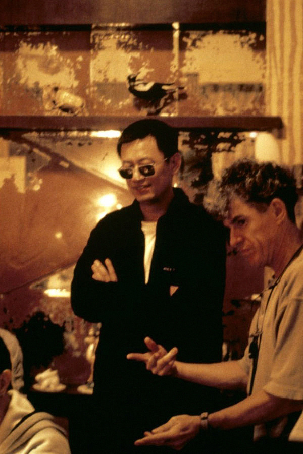 "pickledelephant:  Wong Kar-Wai and Christopher Doyle on the set of In the Mood for Love (2000)  Christopher Doyle Interview Part 1: Why Did Ai Weiwei Shave My Head?  ""Of course they have no fucking idea what cinematography is. The lunatics have taken over the asylum, but you know we have other asylums in other parts of the world and I live in one of them, and I intend to continue to be a lunatic. So fuck you with your… this is the most, hello, the rest of the world just sits back and, when will you fucking connect with what it's really about. It's astonishing. The award is given to the technicians, to the producers, it's not to the cinematographer. I think he should've actually, if it were me, I would've said fuck off. But of course it's his career. Sorry. Personally, as you probably realised, I will say fuck off. If somebody manipulated my image that much, I wouldn't even turn up. Because sorry, cinematography? Really?""  Christopher Doyle Interview Part 2: ""Life of Pi"" Oscar is an Insult to Cinematography"