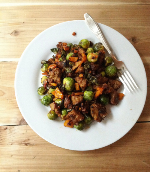 quick dinner: sticky sweet smoky maple-mustard seitan & brussels loosely chop up 1 small onion, 1 small bell pepper, 1-2 cups seitan, and mince two medium cloves of garlic. cut off the hard ends of 1-2 cups brussels sprouts, cut the sprouts in half if you have big ones. i suggest making the seitan in bulk on a sunday afternoon - it saves a ton of time over the week! toss the ingredients in a sautee pan on high heat with 1 tbsp olive oil for about five minutes, stirring occasionally. let the veg cook down & crisp on the edges. once a bit browned, give it a couple squeezes of lemon, a dusting of garlic & onion powder, and stir in 2 tbsp maple mustard. you can either buy this mustard, usually at farms/farmer's markets, or just mix together pure maple syrup and a tart mustard at a ratio of 1:3. WARNING - do not use yellow mustard in this, go for a milder mustard with a kick of tartness at the end, like a nice dijon. after about 5-7 more minutes of cooking, splash on a few drops of liquid smoke and sprinkle on a heaping pinch of sea salt & freshly ground pepper. the brussels should be just a bit crunchy, but soft. stir in a heaping teaspoon of the mustard, to coat. serve hot to 1-2 people.want to see more quick meals, behind-the-scenes, and what we eat on an everyday basis? follow along on instagram! we hope you're having a great new year - we've got lots of diy posts planned (and some in the works currently) for 2013!
